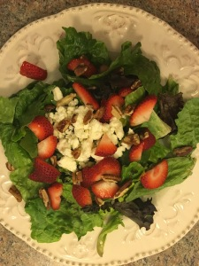 Salad with strawberries, pecans, and feta